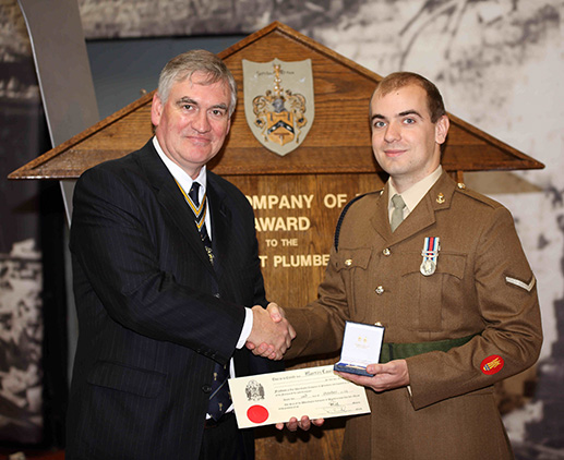Lance Corporal Martin Lambeth receives his award and Freedom Certificate from the Master