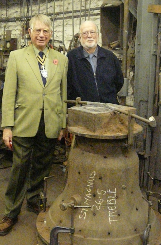 Liveryman Owen Barnes with the newly cast treble bell at the Whitechapel Bell Foundry in November 2008. He is accompanied by the then Master, Rodney Cartwright