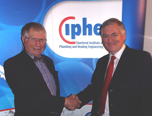Immediate Past Chairman Rodney Cartwright congratulates Nick Gale, the New Chairman