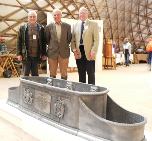 Past Master Edward Hopkinson, the Director of the WDOAM, Richard Pailthorpe, and Liveryman Phil Mead behind a Trough and combined end Planters similar to that specially crafted to mark Her Majesty the Queen's Diamond Jubilee