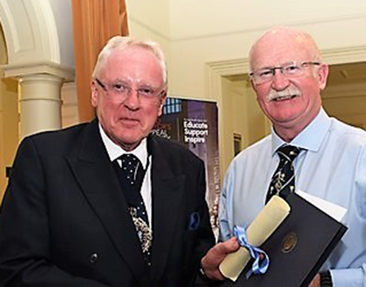 Liveryman Michael Munro receives his award from the Lord Mayor, Alderman Dr Andrew Parmley