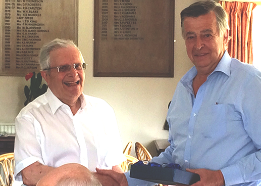 Antony Lowe receives his prize at Sunningdale
