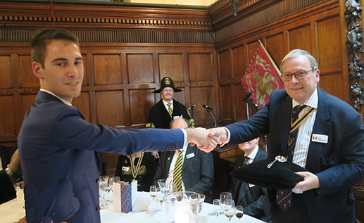 Liveryman Luke Peters presents the Immediate Past master Brian Wadsworth with his Ladle