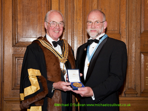 Liveryman John Smartt receives his award from the Master